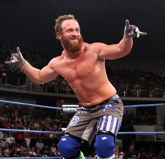 Bearded hobo Eric Young hangs ten on a poor jabronie during TNA IMPACT match